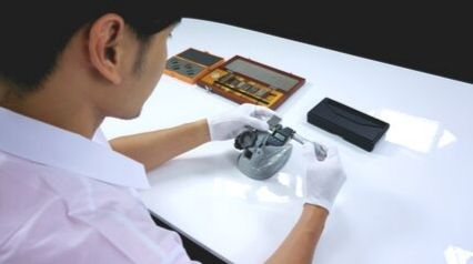 manufacturing worker calibrating instrument for measuring equipment