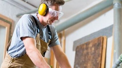 man wearing hearing protection during noise risk assessment