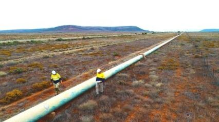 pipeline engineers inspecting for corrosion
