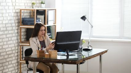 work from home employee using mobile device for working from home checklist