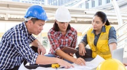 quality engineer writing inspection test plan with peers