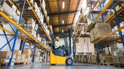 operator using forklift after pre-operation and operational inspections