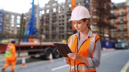 construction safety manager using tablet in construction site