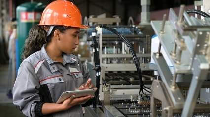 production worker using SMED Lean for manufacturing process